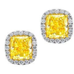 GIA Certified 4.42 Carat Cushion Cut Fancy Yellow Diamond Stud Earrings
