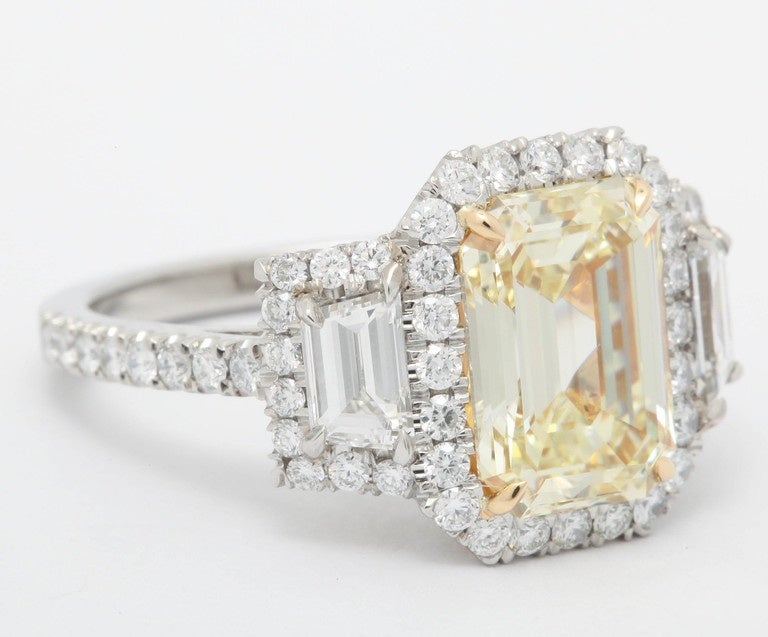 Emerald Cut 3.36 Carat Fancy Yellow Diamond Platinum Ring For Sale