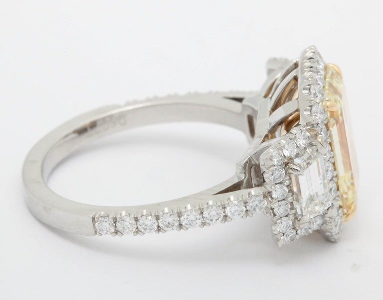 3.36 Carat Fancy Yellow Diamond Platinum Ring In As New Condition For Sale In New York, NY