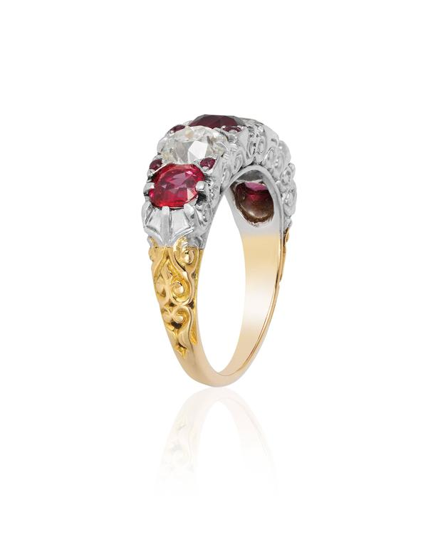 Beautifully crafted, this ring by Tiffany features 3 beautiful Burmese rubies of superb color and clarity weighing approximately 1.8 to 2.2 carats and two Old European diamonds weighing approximately 1.0 to 1.5 carats.  The ring is further enhanced
