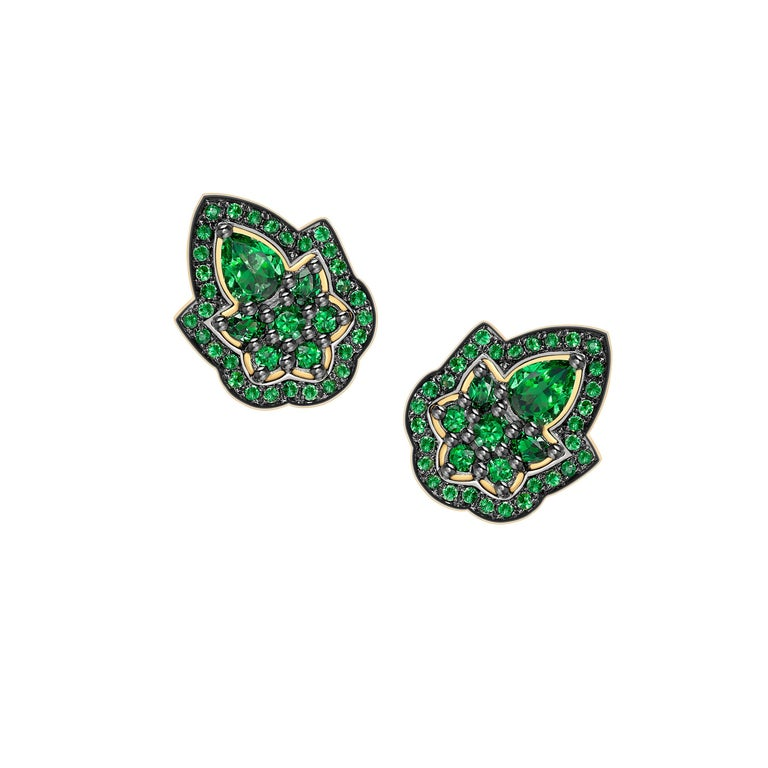 These studs have been handcrafted in London using 18ct yellow gold and are set with 2.40ct of vivid green natural tsavorites. The top of the earrings have a black rhodium finish to contrast with the yellow gold and the vivid green tsavorites.  width
