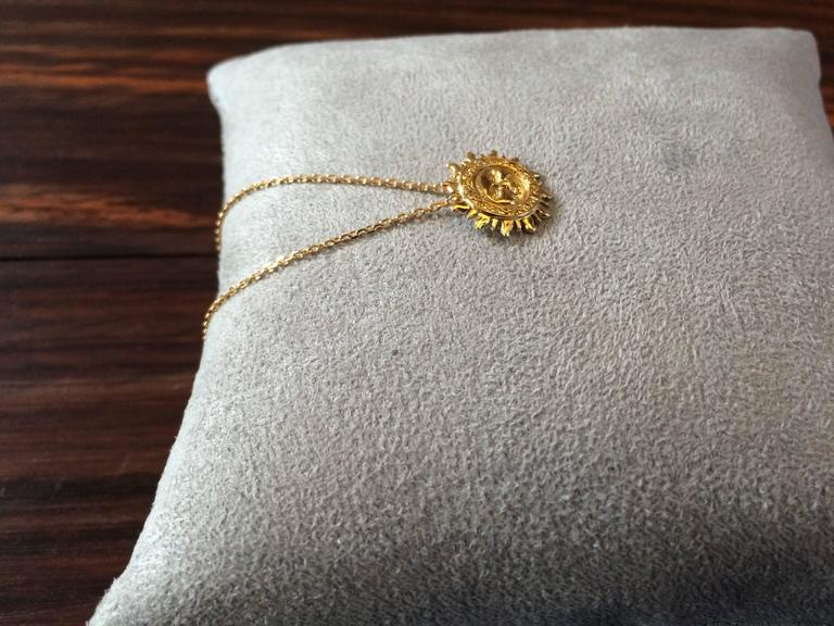 This pendant has been handcrafted from 18ct yellow gold and is pave set with 0.15ct natural canary yellow diamonds.  The total length of the chain is 40cm or 16 inches Diameter of sun: 1.4cm  It is part of Ana de Costa's Alchemy collection and is