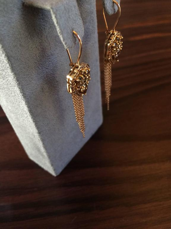These earrings are hand crafted from 18ct rose gold and set with natural cognac diamonds which total 2.06ct. The chain tassels are diamond cut meaning that they sparkle in the light and move freely.  Diameter: 1.4cm Length at longest point: