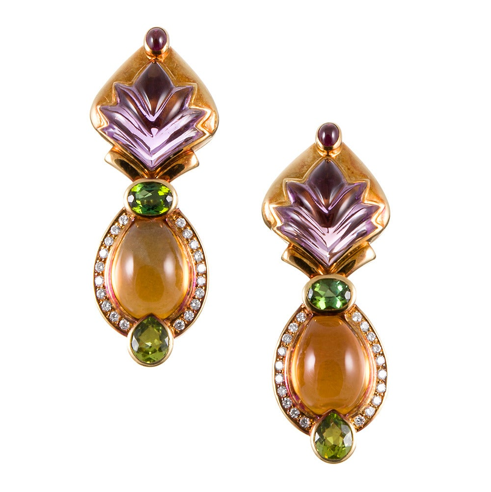 Set in 18k yellow gold, these earrings evoke the feeling of Bulgari's iconic creations (but are offered at a fraction of the price!). Strongly-patinaed yellow gold is the backdrop for plumes of amethyst, bubbles of citrine and orbs of garnet, green