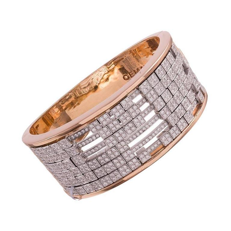 This is such a fun piece to wear, offering movement, bold style and inspired craftsmanship… it even makes a lovely sound when moved around! Designed as a wide bangle which opens with a single hinge, tapering from 1 1/8 to 3/4 of an inch wide at the