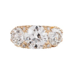 6.62 Carat English Carved Style Three-Stone Diamond Ring