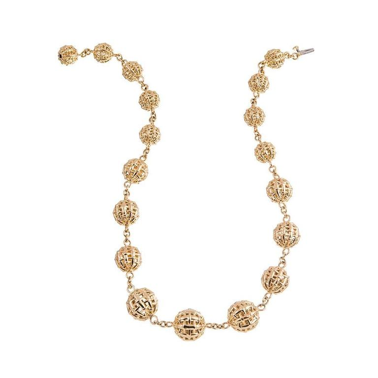 "A collection of graduated orb-shaped links, the hallmark of the ""lightship"" collection, compliments of American jewelry icon Seaman Schepps. The necklace measures 17 inches long. Mounted in 18k yellow gold."