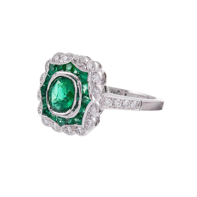Art deco inspired, yet newly made, this ring possesses a vintage aesthetic and the physical integrity of a contemporary piece- a wonderful combination for daily wear. 1.10 carats of emeralds and .26 carats create a beautiful design with an