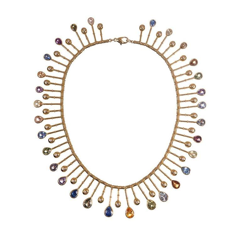 A most impressive creation, possibly inspired by ancient Egyptian adornments, set with thirty assorted color pear shaped sapphires and accented with brilliant diamonds. Each gemstone has been bezel set within its own magic wand shaped extension of