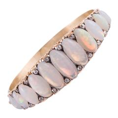 Extra-Large Victorian 30 Carat Opal and Diamond English Carved Bangle Bracelet