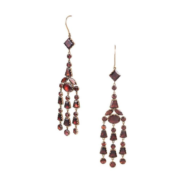An astounding pair of antique earrings, conceived during the Georgian period, circa 1830. We have never seen earrings form this era in such a striking size; the earrings measure nearly 4 inches in overall length, swinging beautifully form your ears