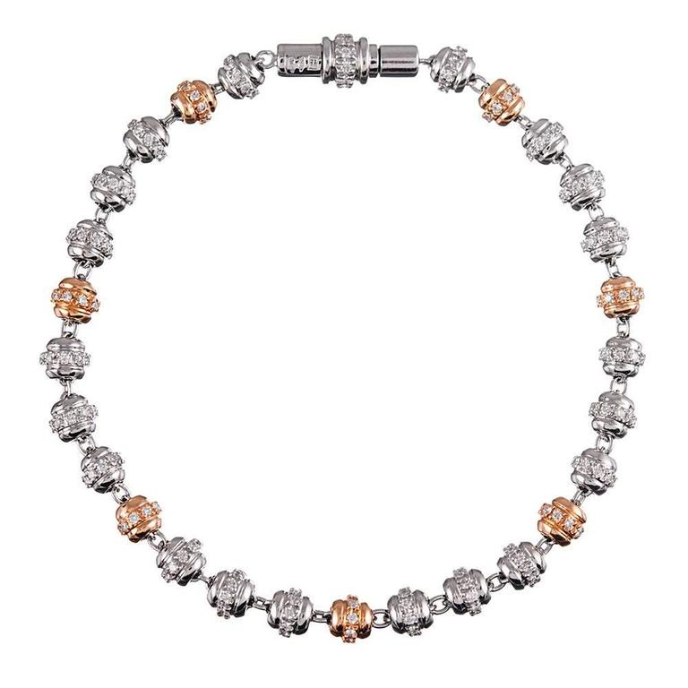 Playful fine jewelry is such a joy! This bracelet consists of rows of white and rose gold orbs, set with brilliant white diamonds (1.40 carats) and finished with a diamond-studded clasp. It is substantial enough to wear on its own, but would also