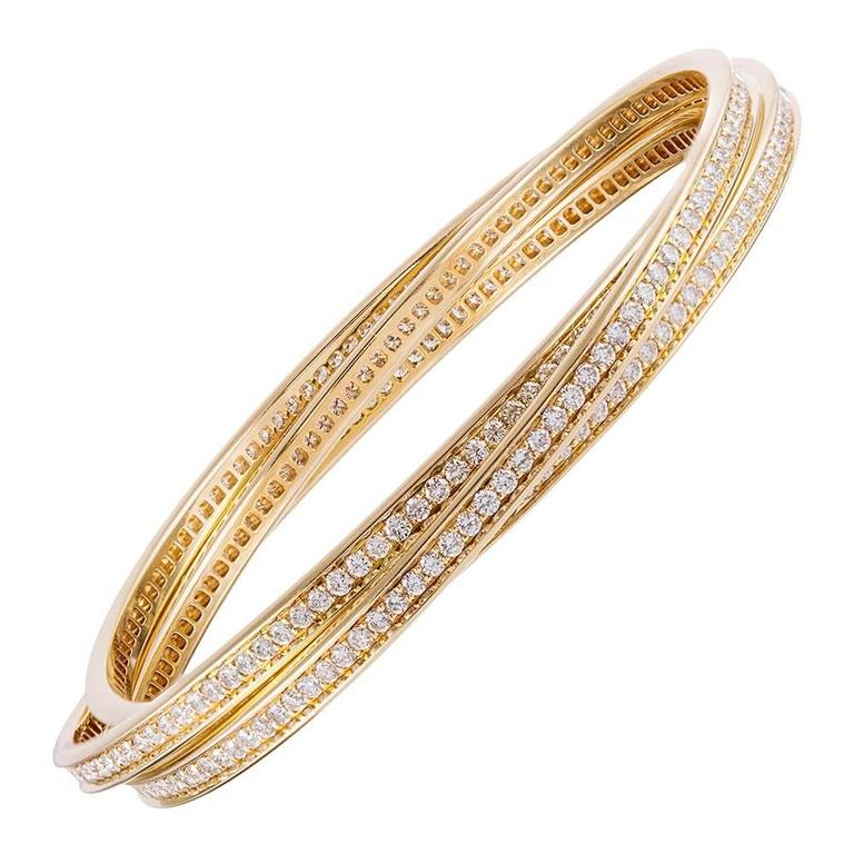 Cartier Trinity Rolling Diamond Yellow Gold Bangle Bracelets For Sale
