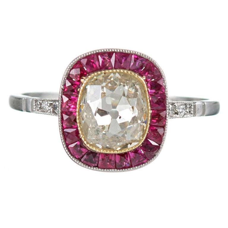 1.25 Carat Old European Cushion Cut Fancy Light Yellow Diamond Ruby Halo Ring For Sale