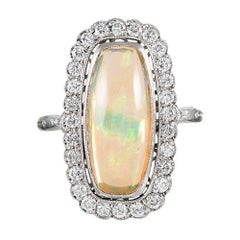 Lozenge-Shaped Opal and Diamond Cluster Ring