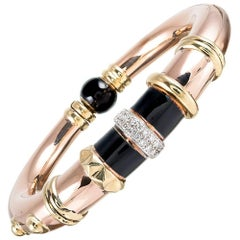 "Onyx and Diamond Bangle Bracelet, Signed ""La Nouvelle Bague"""