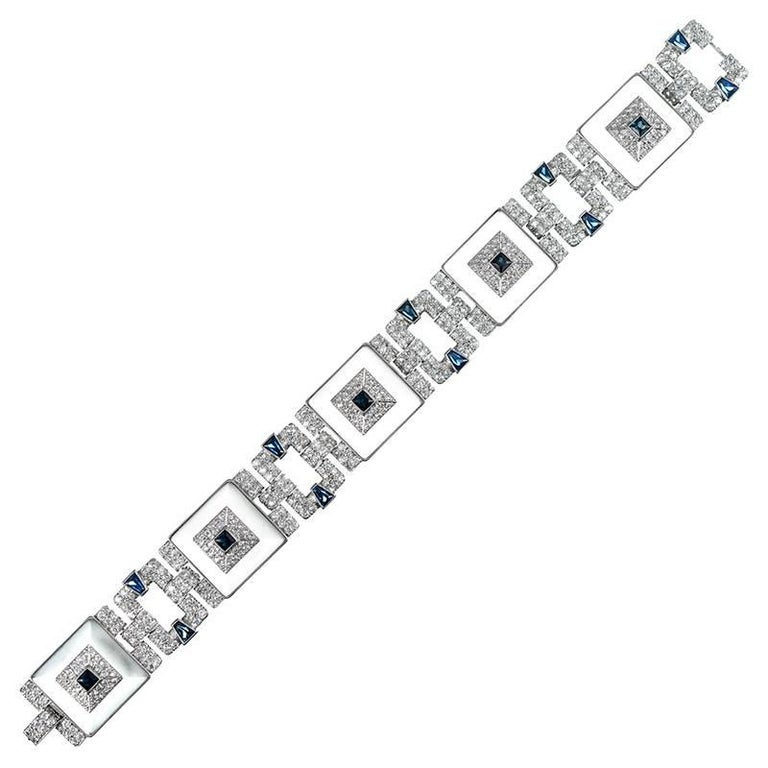 An outstanding creation with striking style elements and glamourous character, the bracelet is comprised of five rock crystal squares, each fashioned into a gentle pyramid shape and topped with brilliant diamond and intense blue sapphire accents.