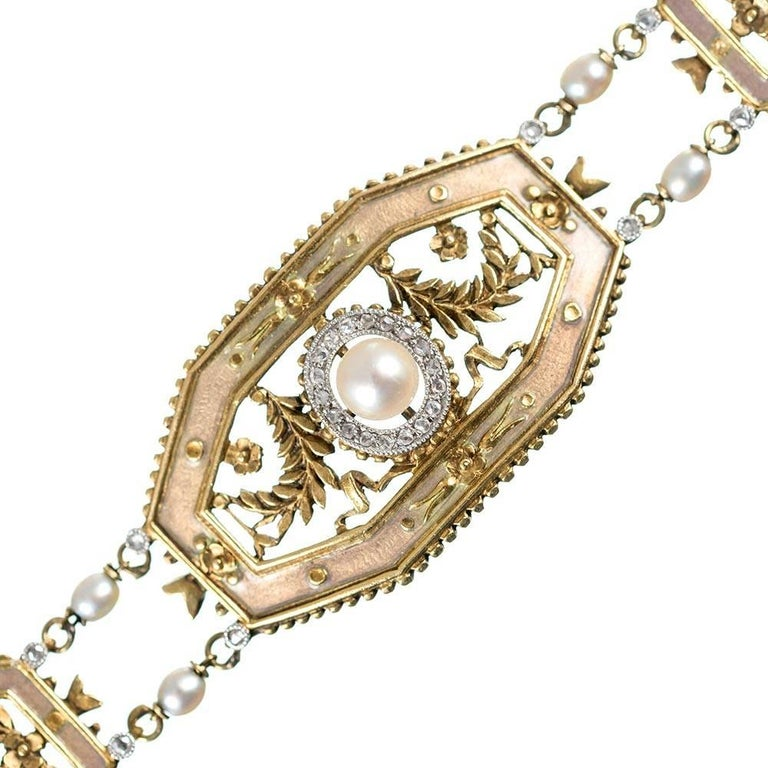 A beautiful and feminine Edwardian design rendered in 18 karat yellow gold, the octagonal links are decorated with rose cut diamonds, pearls, a floral design and a golden-hued enamel to enrich the aesthetic. The bracelet is 7 inches long and 5/8 of