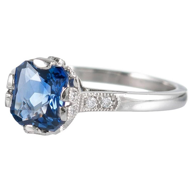Art deco inspired finery abounds with this sweet creation, compliments of London jeweler Lucie Campbell. Rendered in platinum, the ring houses a 1.60 carat cushion-shaped cornflower blue sapphire and is decorated with .15 carats of white brilliant