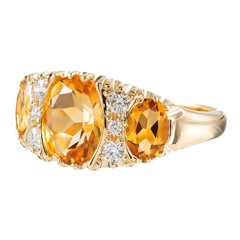 A modern rendering inspired by the classic English Carved rings popularized during the Victorian era, this 18 karat yellow gold ring offers a lovely low profile on the finger while boasting an impactful look from the top. Set with 2.48 carats of