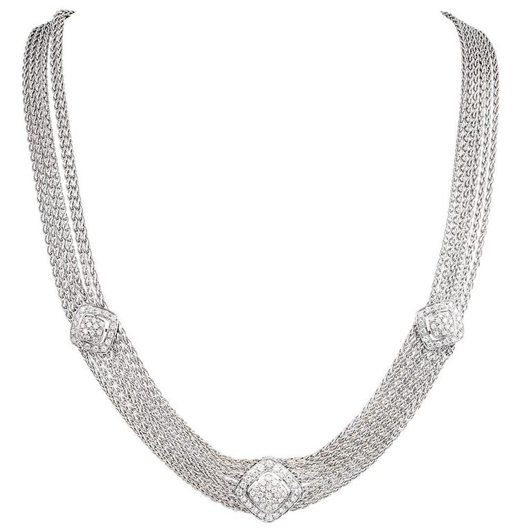 Sensuous and comfortable, the pieces drape effortlessly over your neck and wrist, displaying beautiful movement and a luxurious look that can be worn with both formal and informal attire. The necklace is accented with three diamond-studded stations,