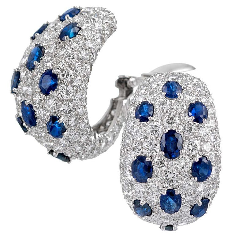 Striking hoop style earrings set with 8.48 carats of brilliant white diamonds and 6.40 carats of faceted oval sapphires, compliments of esteemed American design house David Webb. Although the media will satisfy the sophisticate, the