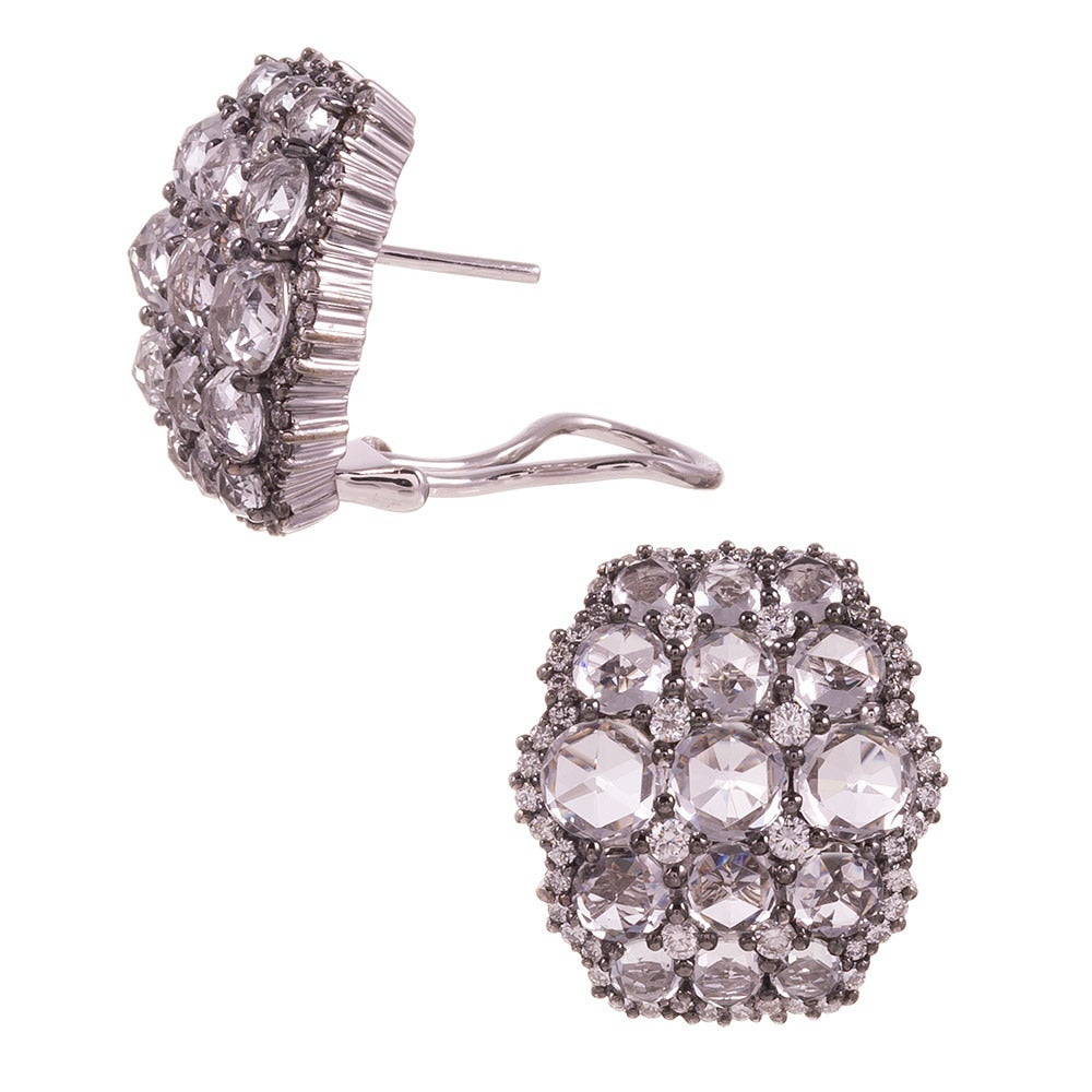 Hexagonal earrings with 1.12 carats of brilliant white diamonds set between rose cut white topaz. These earrings make quite a statement, yet remain fixed to the ears and sophisticated. Currently pierced earrings with a post and Omega style flip-up