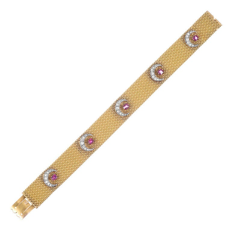 """18k yellow gold mesh bracelet with an absolutely luxurious hand, set with five diamond crescent moons and five round ruby """"stars"""". 6.75 inches long and 9/16 of an inch wide. Magic happens when the moon and stars align…"""