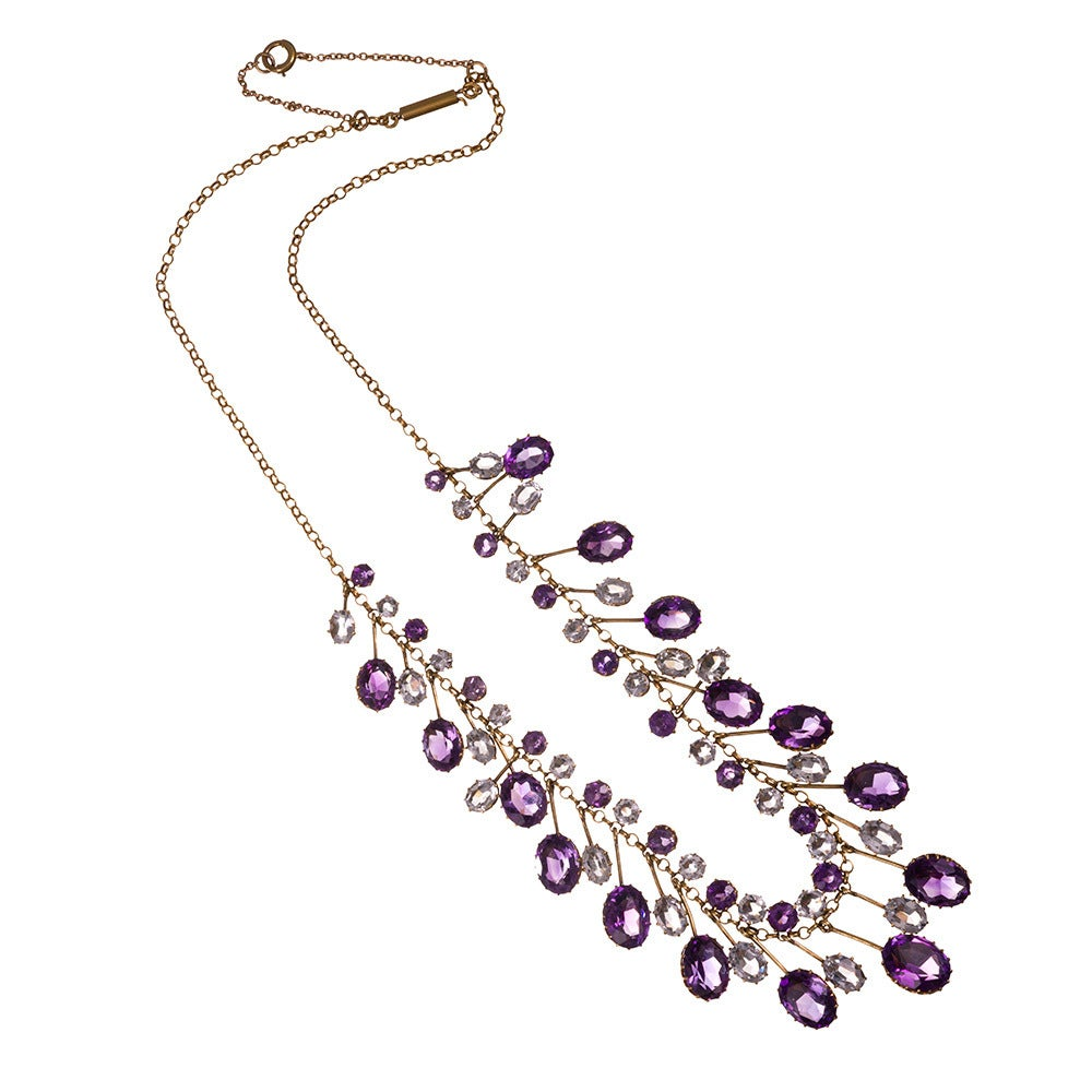 Ultra-feminine necklace in an unusual gemstone combination that looks absolutely stunning when draped on the body; the photos do not do this one justice! Alternating pendants of amethyst and aquamarine encircle the neck in glorious Victorian style.