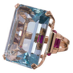 Retro 70.68 Carat Aquamarine and Ruby Gold Ring