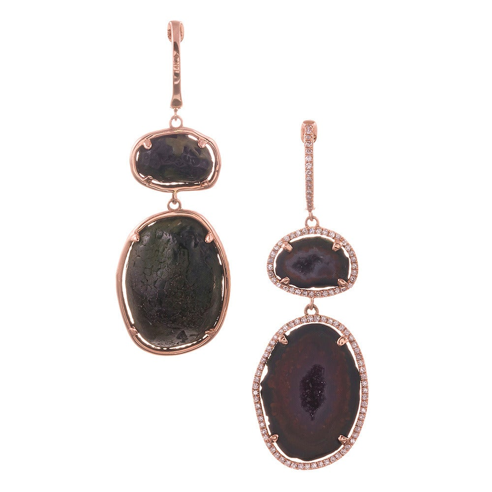 Lovely sets of geodes framed in 18k rose gold and a subtle border of diamonds create the ultimate organic fine jewelry. Measuring 1.75 inches in length, these are the ideal size to wear professionally, casually or elegantly. The closer you look, the