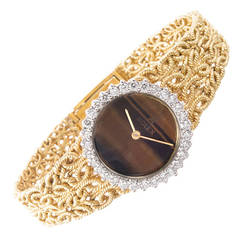 Rolex Lady's Yellow Gold and Diamond Bracelet Watch with Tiger's Eye Dial