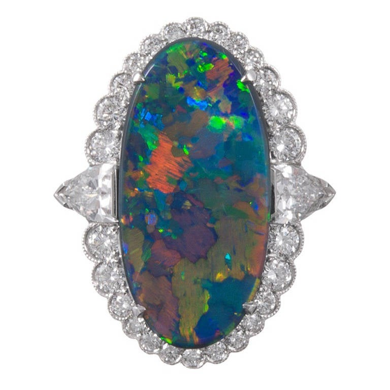 1a48bd85e60812 Important 7.50 Carat Lightning Ridge Opal Diamond Cluster Ring For Sale