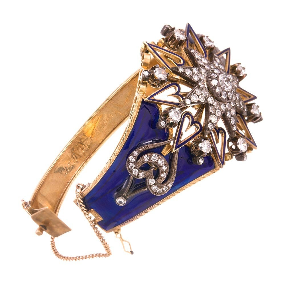 Those with an existing appreciation for fine antique jewelry, take note: this is a truly exceptional piece, both in design and execution. Remarkably preserved royal blue enamel creates a backdrop for a starburst pattern of old European cut diamonds,