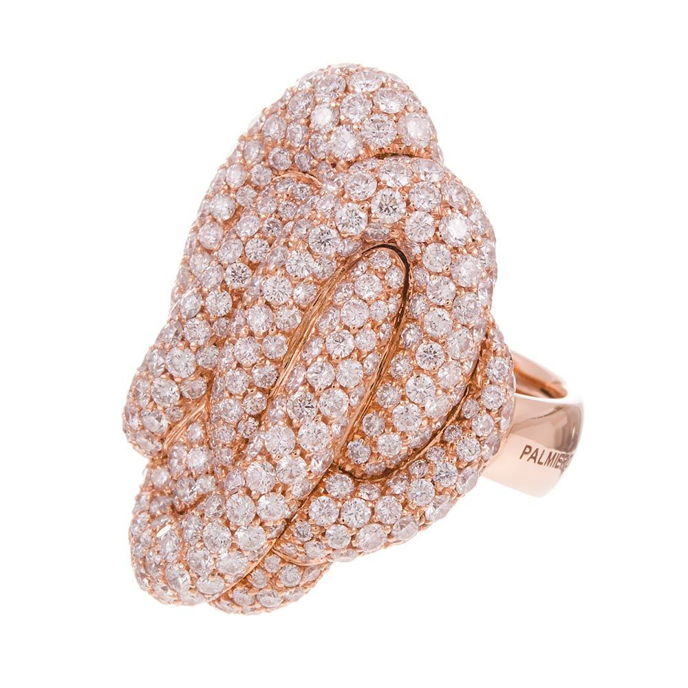 An undulating knot of 18k rose gold and brilliant white diamonds, 6.26 carats in total, grading as E-F color and Vs clarity. This ring had an original retail price of $21,000. Score it for a bargain! We also have another variation of this ring from
