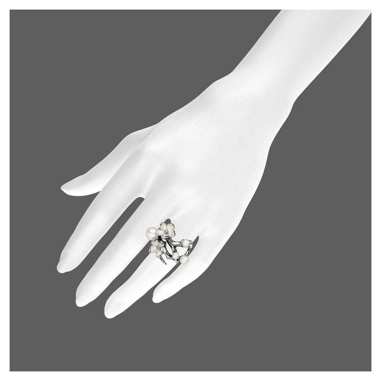 White Diamond, Freshwater Pearl, Enamel and Sterling Silver Blossom Ring from the Shaun Leane 'Cherry Blossom' silver jewellery collection.  Metal: Sterling silver  0.14ct VS2 excellent-cut white diamond Cold Enamel  Hallmarked SL at the London