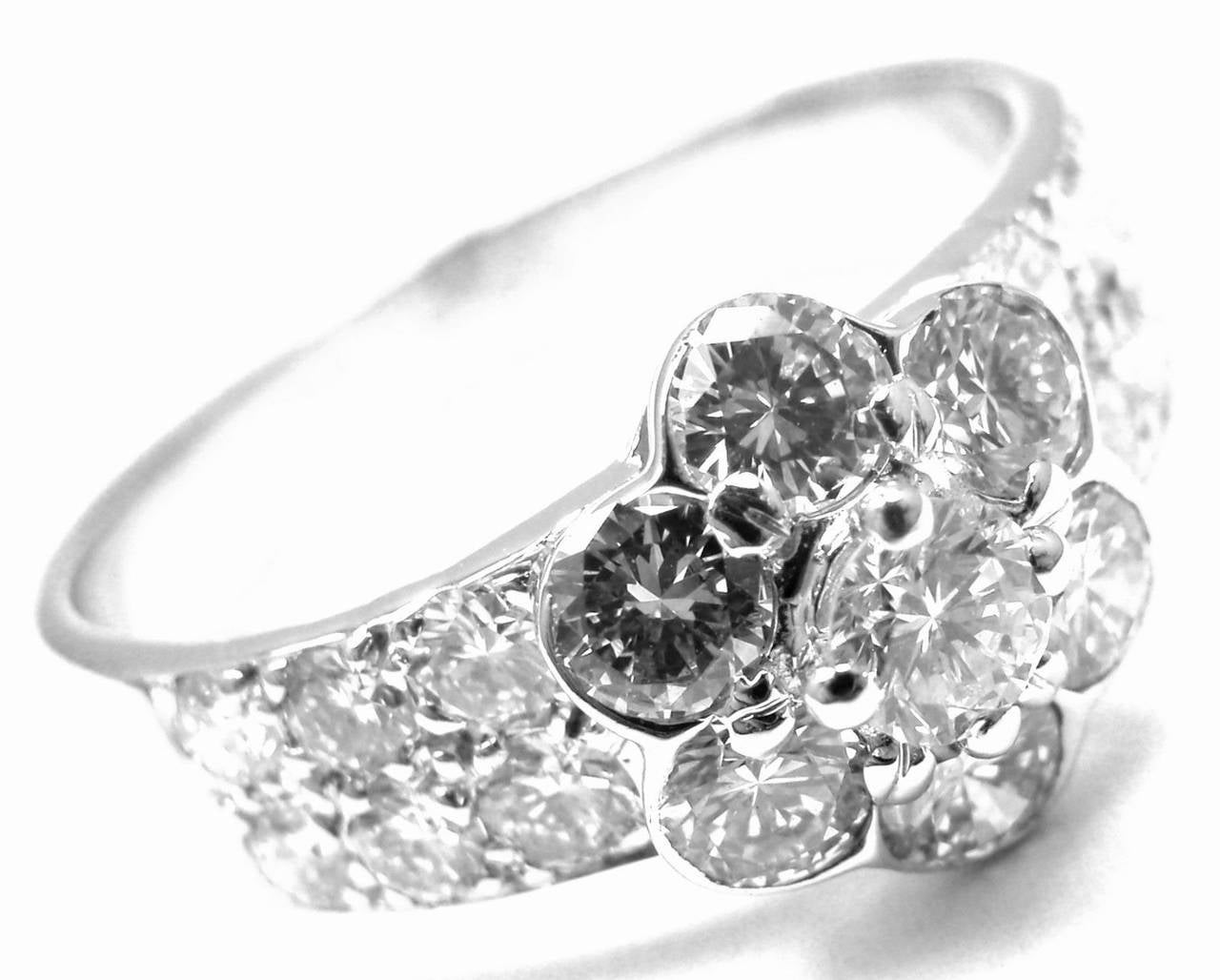 18k White Gold Diamond Diamond Fleurette Flower Ring by Van Cleef & Arpels. With 19 round brilliant cut diamond VS1 clarity, G color total weight 1.14ct  Details: Size: 6 Width: 9mm Weight: 3.4 grams Stamped Hallmarks: VCA 750 18k B5790 A25