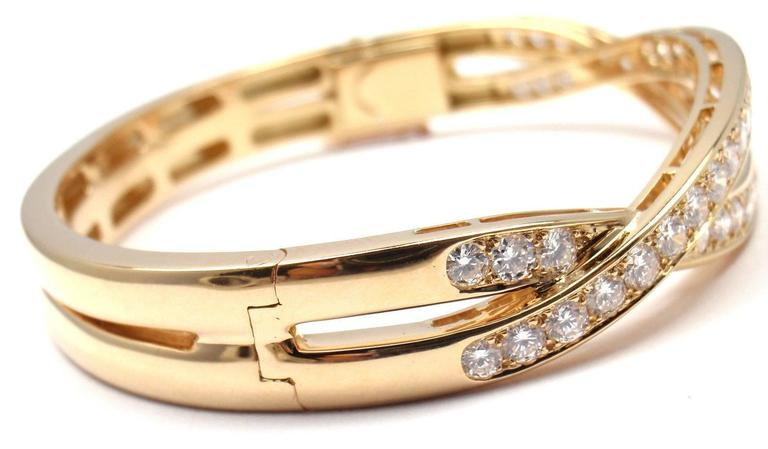 18k Yellow Gold Diamond Bangle Bracelet by Van Cleef & Arpels. 