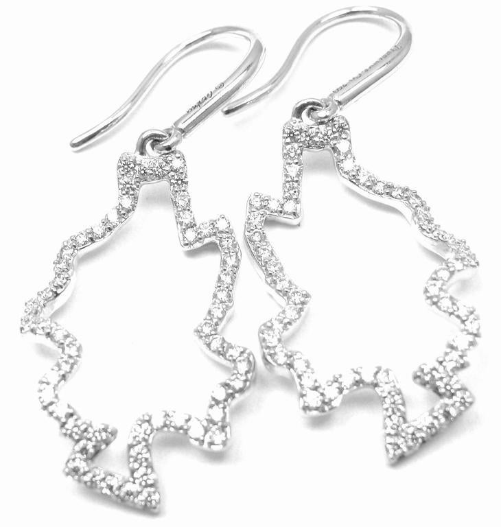 18k White Gold Diamond Leaves Earrings by Frank Gehry for Tiffany & Co.  With 112 round brilliant cut diamonds VS1 clarity, G Color .44ct  Details:  Weight: 3.5 grams Dimensions: 324mm x 3.5mm Stamped Hallmarks: Tiffany & Co Gehry 750 *Free