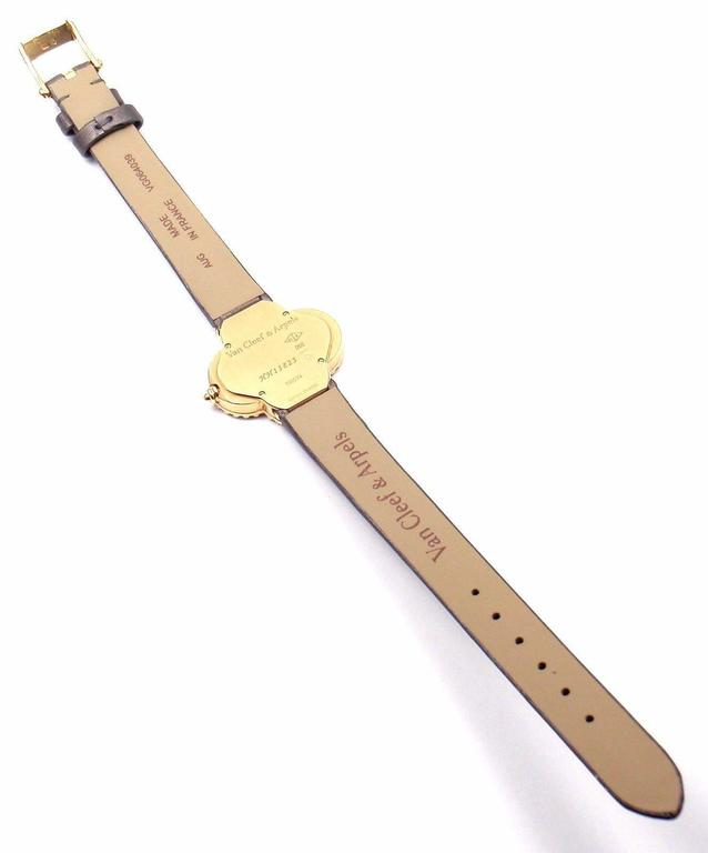 Women's or Men's Van Cleef & Arpels Black Dial Vintage Alhambra Yellow Gold Ladies Watch For Sale