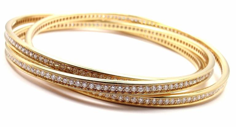 18k Yellow Gold Diamond Trinity Bangle Bracelet by Cartier. 