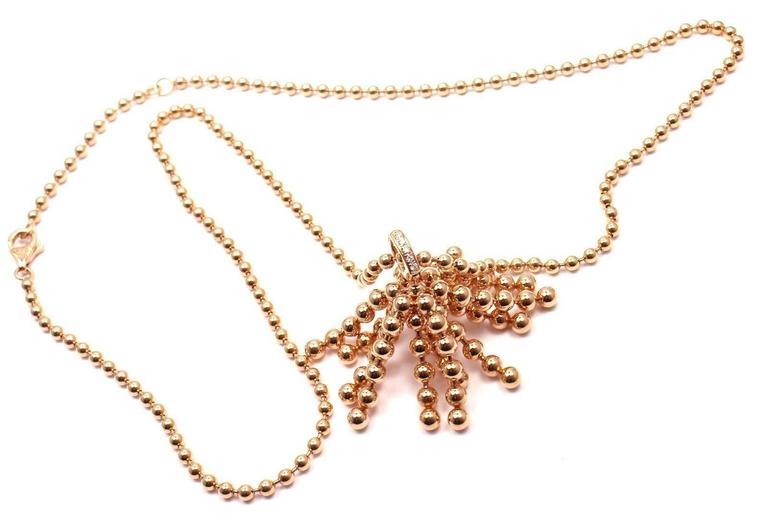 18k Rose Gold Diamond Paris Nouvelle Vague Pendant Necklace by Cartier.   With 5 round brilliant-cut diamonds VVS1 clarity, E color totaling 0.10ct This necklace comes with original Cartier box and a Cartier certificate.  Details:   Length: