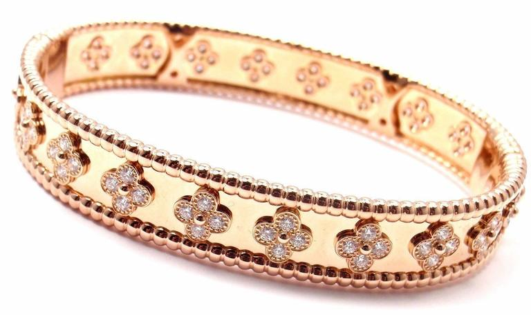 18k Rose Gold Diamond Clover Perlee Bangle Bracelet by Van Cleef & Arpels.   With 80 brilliant round cut diamond VVS1 clarity, E color Total weight approx. 1.78ct This bracelet comes with original Van Cleef & Arpels certificate. Retail Price: