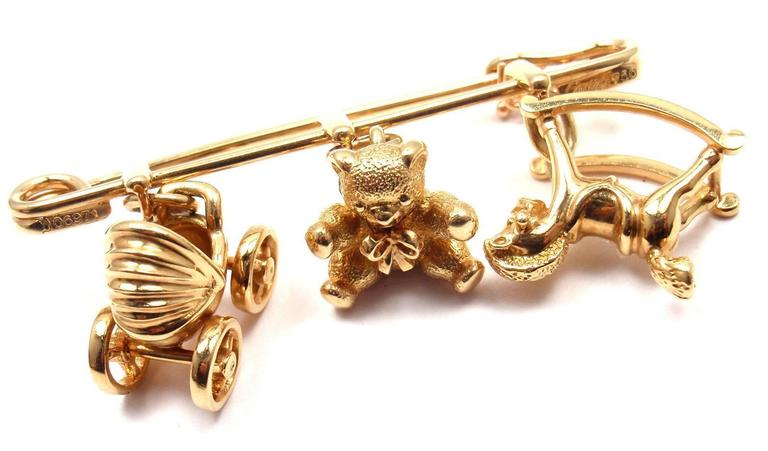 6fd2da85519db Cartier Three Baby Related Charms Yellow Gold Safety Pin Brooch