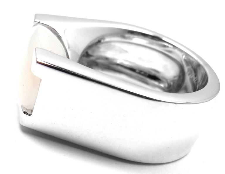 18k White Gold Large Moonstone Ring by Cartier.  With 1 oval moonstone 10mm x 15mm.  This beautiful ring comes with an original Cartier box.     Details:   Ring Size: 5 1/4 US, European 50 Weight: 19.3 grams Width: 10mm Stamped Hallmarks: Cartier