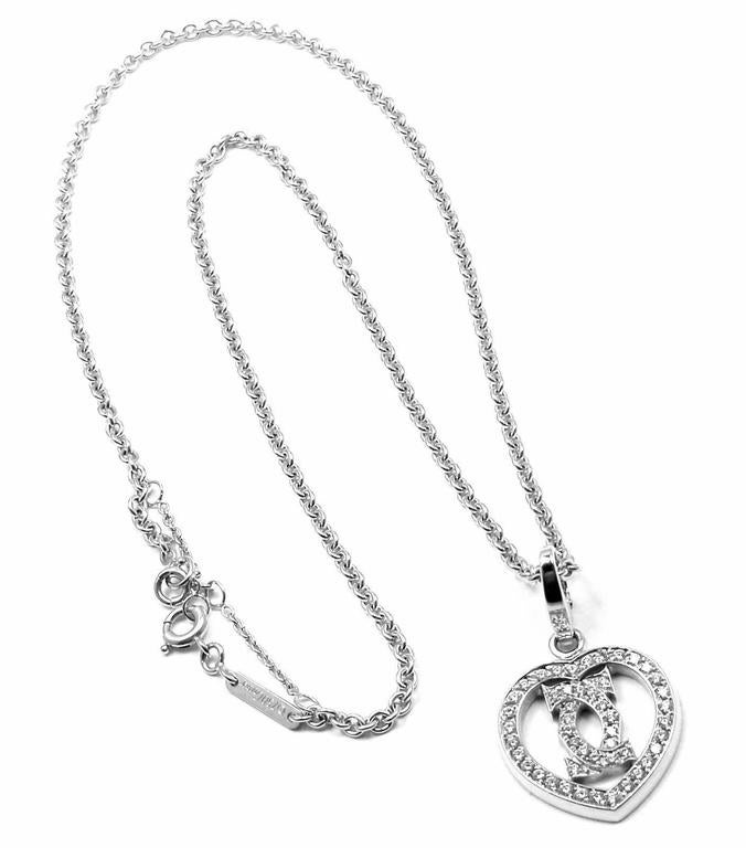 18k White Gold Diamond Heart Double C Pendant Necklace by Cartier. With 49 round brilliant cut diamonds  VVS1 clarity, E color total weight approx. .50ct This necklace is in mint condition and comes with original Cartier box.  Details: Chain Length: