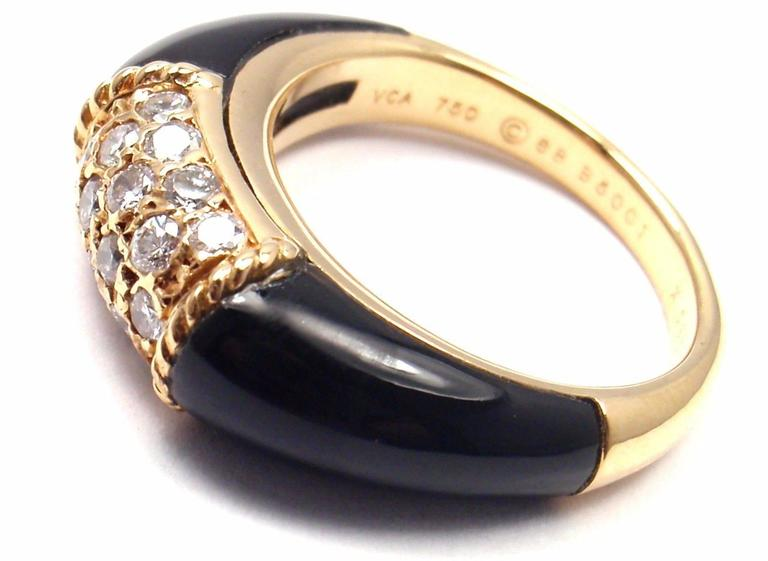 18k Yellow Gold Diamond Black Onyx Ring by Van Cleef & Arpels.  With 19 round brilliant cut diamond VS1 clarity, G color total weight .50ct Onyx. And 2 beautiful black onyx stones.  Details:  Size: 6 Width: 7mm Weight: 7.2 grams Stamped