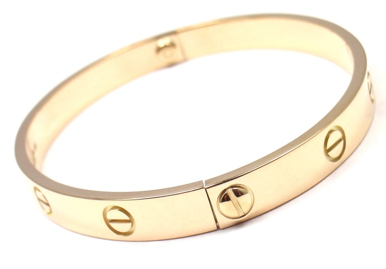 18k Yellow Gold Love Bangle Bracelet by Cartier Size 18. This bracelet comes with a Cartier box and a Cartier screwdriver.  Details:  Size: 18 Weight: 31.9 grams Width: 6.5mm  Hallmarks: Cartier 750 18 D22290  *Free Shipping within the United