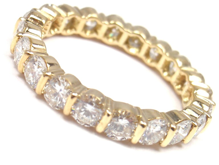 18k Yellow Gold Diamond Eternity Wedding Band Ring by Tiffany & Co.  With 20 round brilliant cut diamonds VS1 clarity, G color total weight  approx. 2ct Details:  Ring Size: 6 Weight: 2.7 grams  Width: 3.5mm  Stamped Hallmarks: T&Co 750  *Free