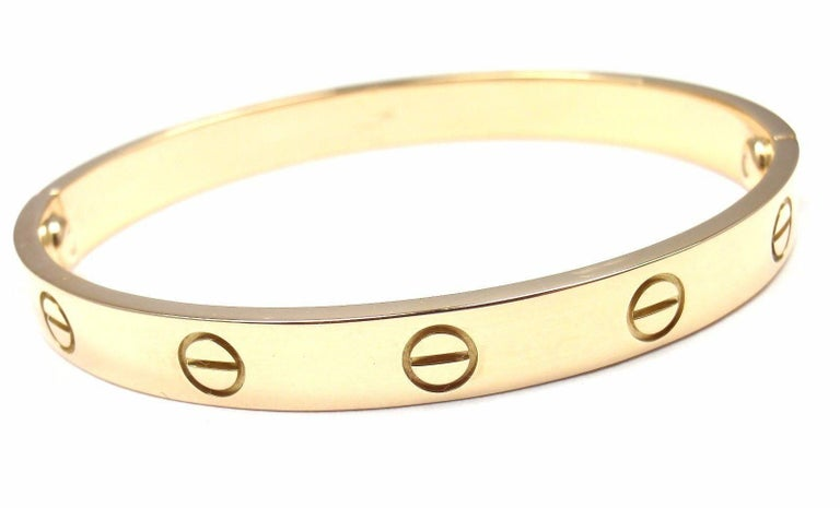 18k Yellow Gold Love Bangle Bracelet by Cartier Size 16. This bracelet comes with a Cartier box, Cartier certificate and Cartier screwdriver.  Details:  Size: 16 Weight: 29.4 grams Width: 6.5mm  Hallmarks: Cartier 750 16 M08287  *Free Shipping